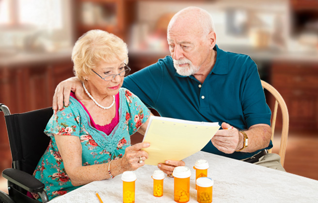 Elderly couple looking at medical bills